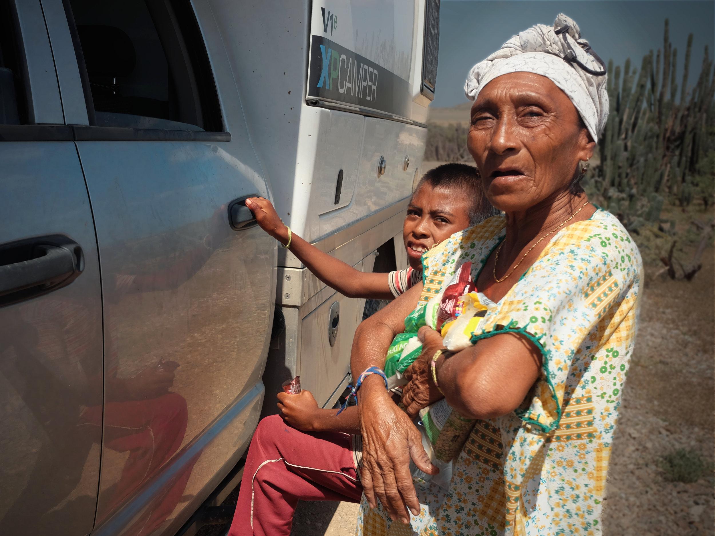 A Wayuu lady holding some donated food