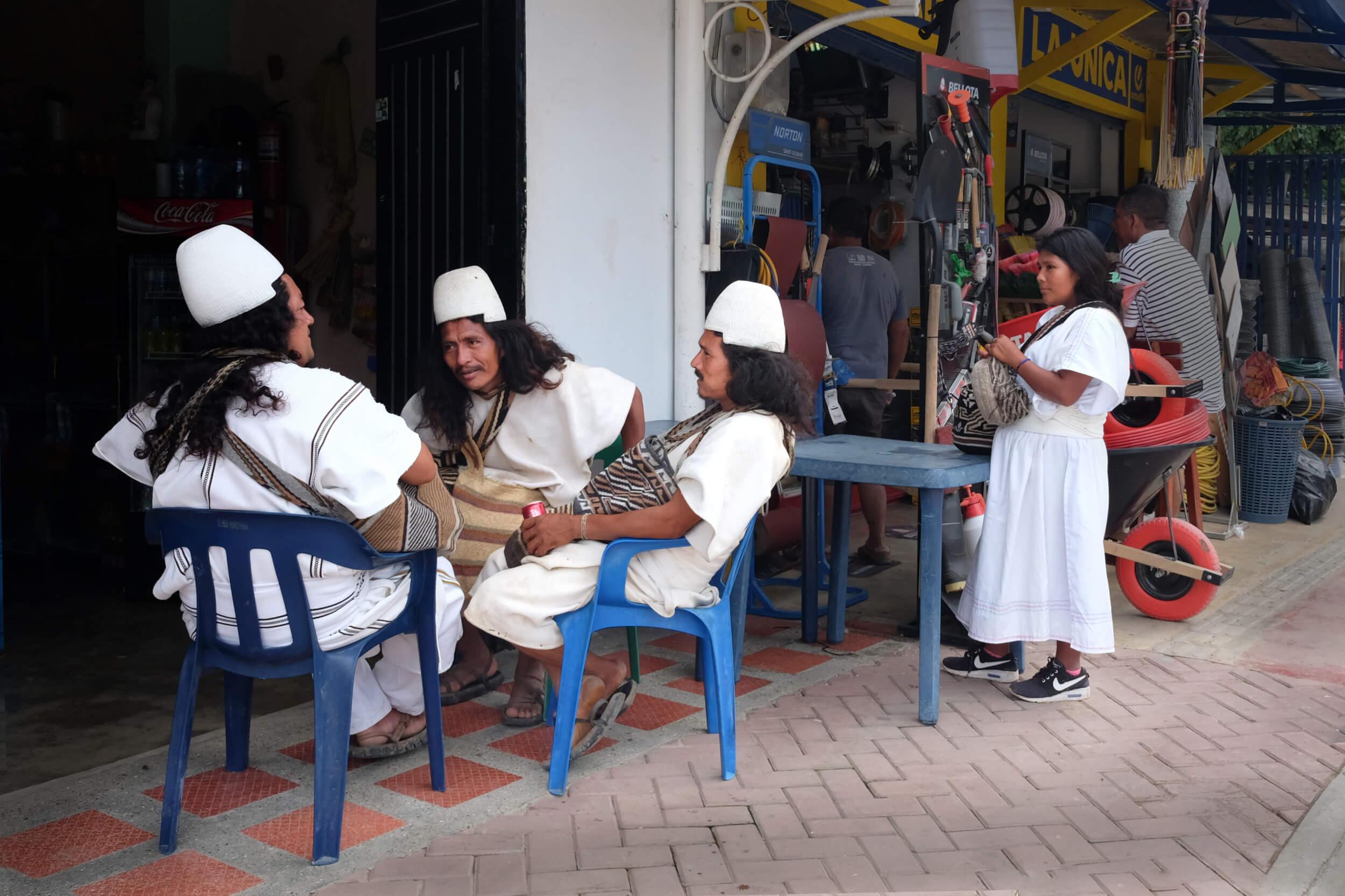 arhuaco men enjoying a cola
